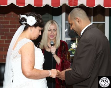 Andrea_Brock_Healing customized ceremony outdoors bride groom red awning